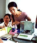 Broker checking weight in Gemsbrokers trading office in Chanthaburi, Thailand
